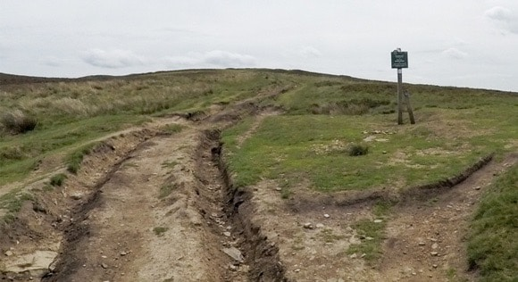 Signpost and damaged path to Win Hill
