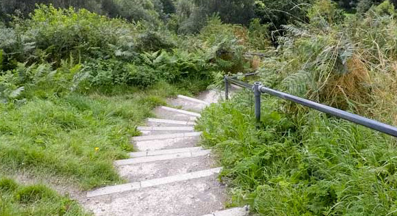 Steps leading down from top of white horse