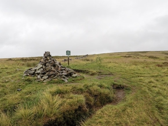 cairns and signpost