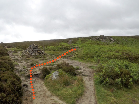 Cairn and path with route